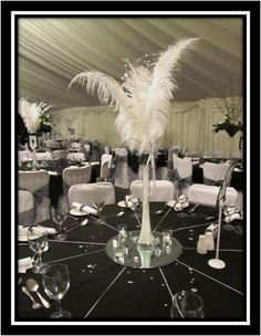 Dramatic ostrich feather centrepieces for a black and white wedding reception table