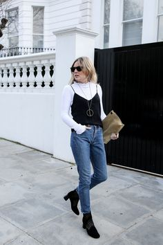 Silk camisole | Raey at Matches Ribbed ruffle top | Asos Jeans | Levis at Reformation Necklace | Jenny Bird Clutch | Loewe Boots | Sandro Sunglasses | Rayban