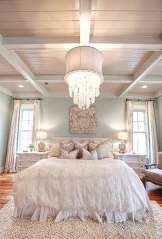 We are loving everything about this room - from the high ceilings, to the neutral colors to the mixed textures. This is a dream bedroom for sure!