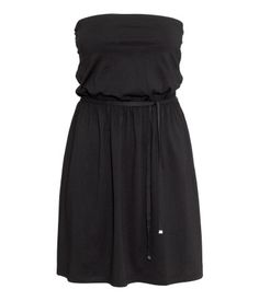 Strapless dress in jersey. Elasticized waist with a tie. Liner top with elasticized upper edge.