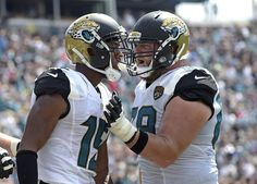 Indianapolis Colts vs. Jacksonville Jaguars: RECAP, score, stats in London (10/2/16), NFL Week 4  -  Jacksonville Jaguars wide receiver Allen Robinson, left, celebrates his touchdown against the Baltimore Ravens with teammate offensive guard Tyler Shatley, right, during the first half of an NFL football game in Jacksonville, Fla., Sunday, Sept. 25, 2016. (AP Photo/Phelan M. Ebenhack) (Phelan M. Ebenhack)