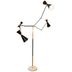 Charming 1950s Floor Lamp | From a unique collection of antique and modern floor lamps  at http://www.1stdibs.com/furniture/lighting/floor-lamps/