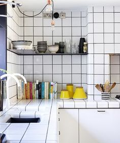 Grey grouting highlights the white tiles.