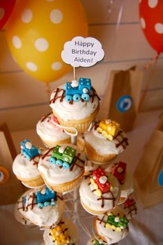 train cupcakes with lego candy trains and cloud sign from train