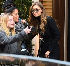 What a day! The top model wrapped up warm in a chic winter coat as she greeted fans the morning after her triumphant turn on the runway for Victoria's Secret