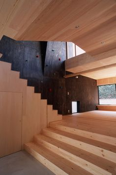 japanese architecture firm dai nagasaka / mega has designed 'arashiyama', a two-storey  private residence for a couple in kyoto, japan. located at the foot of the arashiyama mountain,  the design seeks to provide a spatial transition between the street and the rising topography beyond.