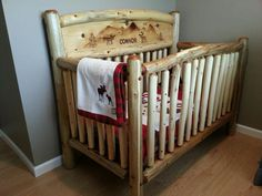 My talented husband made this rustic log crib for our friends.