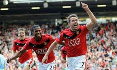 Michael Owen wheels away after netting the late winner vs Man City in a 4-3 win. One of the best games l ever saw.