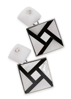 A pair of cuff links  18 kt. white gold, with mother of pearl, white agate, onyx and 2 round brilliant cut diamonds.