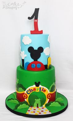 Mickey Mouse Club House inspired first birthday cake! #MickeyMouse #Club #House Birthday Cake#mickeymouseclubhouse #birthdaycakeideas #mickeymousecakes
