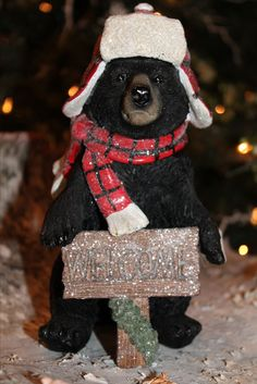 BLACK BEARS WITH HATS Adorable black bears with glittered plaid hats and scarves showing signs of the season to come with there welcoming favorites, wreath, sign and of course the family christmas tree. SHOP www.exclusivelychristmas.com