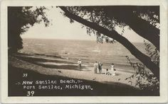 a family checks out the sand and shore of what was a new public beach area in Port Sanilac in the 1930's.