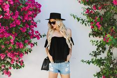 Easy Summer Outfit: Black off the shoulder with jean cut off shorts. Don't forget the cross body bag and top it off with a hat