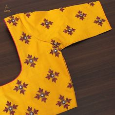 Designed with kundhan, zardosi, sequence and swaroski this customized blouse has a warm colour tone and a vibrant appeal. Designed with kundhan, zardosi, sequence and swaroski this customized blouse has a warm colour tone and a vibrant appeal. Kids Blouse Designs, Simple Blouse Designs, Stylish Blouse Design, Fancy Blouse Designs, Bridal Blouse Designs, Blouse Neck Designs, Hand Designs, Sari Design, Maggam Work Designs