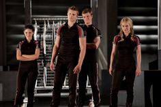 Isabelle Fuhrman as Clove, Alexander Ludwig as Cato, Jack Quaid as Marvel, and Leven Rambin as Glimmer in The Hunger Games.