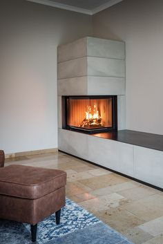 Der Brunner Systemkamin ist als cleveres System schnell im Wohnraum aufgebaut. The Brunner system chimney is a clever system designed quickly in the living room. The timeless concrete look Fireplace Inserts, Modern Fireplace, Fireplace Wall, Fireplace Design, Corner Fireplaces, Fireplace Dimensions, Electric Fireplace Tv Stand, Basement Living Rooms, Tv Stand With Storage