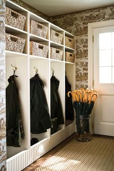 Mudroom - I like the basket shelves and the open locker partitions, but most of all, i like how the bottom of the locker partitions are concealed to clean up the appearance (so you don't see the shoes)