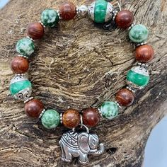 This bracelet is made of silver topped jade beads, wooden beads and an elephant charm.  I've just added it to my website: www.zerenitytreasures.com Beaded Necklace, Beaded Bracelets, Elephant Bracelet, Silver Tops, Jade Beads, Wooden Beads, Artisan Jewelry, Different Styles, Treasures Jewelry
