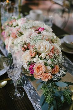 Rose and baby's breath centerpiece | BlueSpark Photography | see more on: http://burnettsboards.com/2014/04/bohemian-villa-inspiration-shoot/