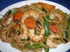Spaghetti Spicy Noodles :Spaghetti stir-fried with meat and fresh chili, bell pepper, onion, tomatoes, carrot, mushrooms, baby corn, and basil. #chicken #Noodles #meat #vegetables #Awesome Thai #Food forked.com