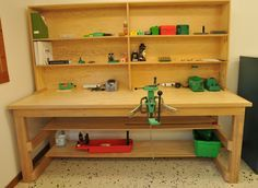 """Very nice reloading bench. 8' x 3' x 36"""" tall. Upper shelf unit 10"""" deep, 42"""" tall. Frame, fir 2x4s; bench top, 2 sheets 3/4"""" fir plywood. It's solid! Turret press not bolted down yet."""