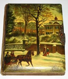 """LOVELY CELLULOID PHOTO ALBUM - VICTORIAN CHRISTMAS    This is such a beautiful antique celluloid photo album. The cover shows a wintery Victorian scene with a lovely Victorian mansion and a horse drawn sleigh. The detail and colors are fabulous. Celluloid is in excellent condition. The back and spine are a patterned vevlet. The brass clasp is intact. The pages show normal age discoloration. Measures 10 1/2"""" x 8 1/2""""."""