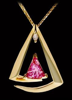 Radial Ray™ cut Hot Pink Tourmaline By John Dyer & Co. In a Gold pendant with Diamond accent designed by Renee Schatzley of Renee Schatzley's Designs