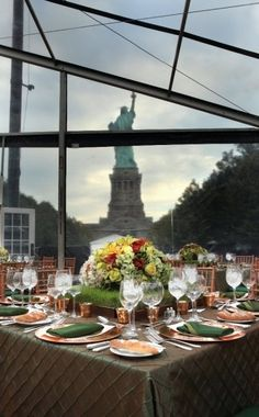 Another pretty view of the Liberty Island wedding clear span tent setup, with colors matched to the surrounding trees.