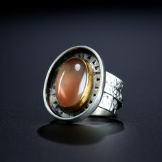 Sunstone Ring. Fabricated Sterling Silver and 22k Gold. www.amybuettner.com https://www.facebook.com/pages/Metalsmiths-Amy-Buettner-Tucker-Glasow/101876779907812?ref=hl https://www.etsy.com/people/amybuettner http://instagram.com/amybuettnertuckerglasow