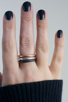 set of three mixed metal stacking rings in black, bronze, and silver