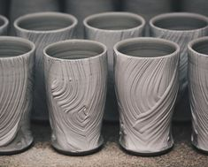 Glistening beer cups, having been freshly slipped they'll only remain crisp like this for a short amount of time before slowly drying out and softening down.  This surface texture is achieved with a coarse, straw hakame brush, which I showed an example of using in my latest video. By gripping the base with two fingers and a thumb I brush the thick slip from bottom to top. Energetic, fast movements provide the best marks, any hesitation in the process is obvious. I always mention how much I…
