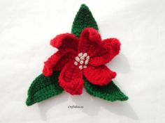"""Crochet Poinsettias. It screams: """"Wear me like a broach!"""" Would make an awesome gift for a teacher or to give out to friends! Make a few to pass out at your local nursing home. Looks like another """"make-up-quick"""" gift idea to me! ¯\_(ツ)_/¯"""
