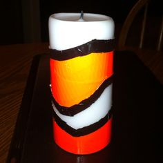 Finding Nemo candles to use in centerpieces on tables for Mia's Finding Nemo party. Designed out of duct tape on white candles.