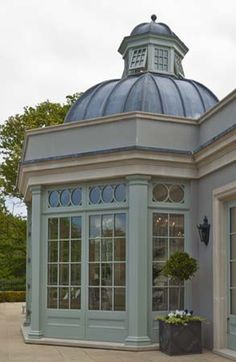 An impressive glazed extension with domed leaded roof with a copula roof lantern.