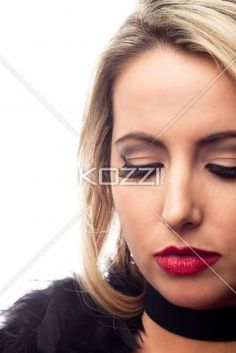 young woman with eyes closed. - Close-up of a beautiful young woman with eyes closed over white background, Model: Nadine Yelovich
