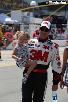 NASCAR driver Greg Biffle and his daughter Emma. (Photo by Elmer Kappell for NASCAR Illustrated, Michigan International Speedway, June 2014.)
