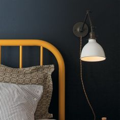 Dark grey walls + orange bed frame [linens by Egg Press + Schoolhouse Electric; lamp by Schoolhouse Electric]. Steel Bed Frame, Yellow Bedding, Yellow Headboard, Deco Kids, Schoolhouse Electric, Dark Walls, Grey Walls, My Living Room, My New Room