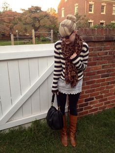 black/white stripe sweater over white tunic, black leggings, brown boots, leopard scarf