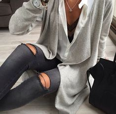 Cardi, blouse and ripped jeans