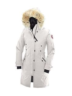 Canada Goose Women's Kensington Down Parka..It is possible to be warm without adding unwanted bulk to your silhouette as the Kensington Parka proves so beautifully. Long and slim-fitting the Kensington is insulated with 625 fill power white duck down and features a two-way adjustable fleece-lined down hood with a removable coyote fur ruff making it equally appropriate for strolling a city street or hiking a snowy trail at the lake.