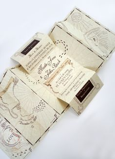 """This is my favorite for a HP themed wedding! I love how the invitations are a map of the couple! A Marauder's Map """"guest book"""" would be awesome too!! Everyone could sign inside of the little ribbon pieces that normally show the names of people!"""