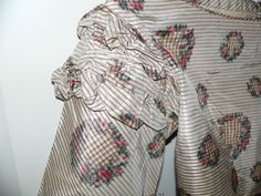 """sleeve detail - 1860's Civil War Silk Bodice with Pagoda Sleeves, ebay seller avivb, this estate had another bodice in this same fabric; piping at neck; hem & shoulders are piped except where bodice was taken apart; one stay is under the back eyes, lined with cream cotton, sleeves partially lined in cream silk; back hook & eye closure; bust: 30""""; waist: 24""""; length: abt 21"""", no underarm discoloration"""