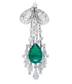 Harry Winston; A brooch with 1 pear-shaped Colombian emerald, 13.34 carats, and 91 round brilliant, baguette, and pear-shaped diamonds weighing a total of 16.39 carats, set in platinum.