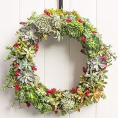 Greenery inspired Christmas wreath. The lush green colors on the wreath gives it a very fresh vibe that you simply would love to look at it. The flowers and the red berries also add as accent to the design.
