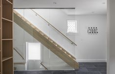 View of Staircase Tagged: Staircase, Glass Railing, Wood Tread, and Wood Railing. North Toronto Addition by Asquith Architecture. Browse inspirational photos of modern staircases. Stainless Steel Staircase, Wood Railing, Light Hardwood Floors, Modern Stairs, Stone Slab, Modern Glass, Wood Cabinets, Detached House, Modern Architecture