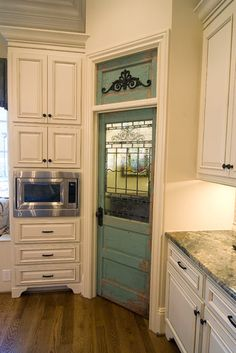 I love the antique pantry door -- both the style and color. It works great with the style of the kitchen. I like the style of the cabinets.