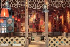 The walls are covered in authentic Turkish carpets and kilim patchwork which contribute to a sense of warmth and intimacy. The abundance of carpets and hanging lights are meant to recall the typical busy bazaar feeling.