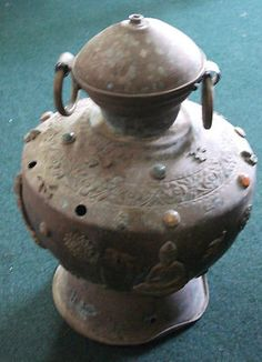 Large vintage Asian Brass Urn with Buddah and Carvings and stones