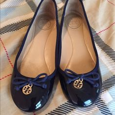HP Tory Burch Chelsea Navy Ballet Flat!! Authentic Tory Burch Navy patent leather ballet flat with bow!! Tory Burch logo charm. Bow is made of rope/shoelace-like. In excellent condition, worn only a few times! Size 6. I don't have box anymore, only dustbag Tory Burch Shoes Flats & Loafers