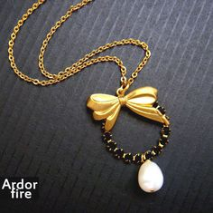Golden bow jet black crystal round and white water by ardorfire, $32.00
